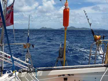 sailboat cruising, trolling rods and reels on Alacazam