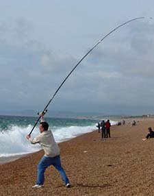 surf casting off Dorset's famous Chesil Beach.