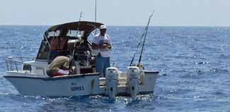 two anglers enjoying a saltwater fishing trip at anchor off Anguilla in the West indies