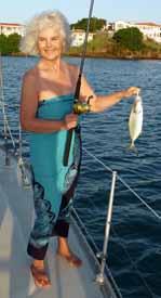 Mary fishing at anchor